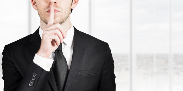 businessman-silent-quiet-gesture